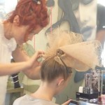 Chilli Couture hairdresser styling the hair of a blonde model fro Zhivago