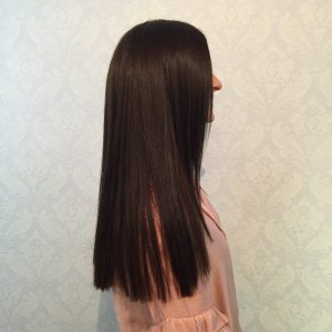 best hairdresser perth performs beautiful long hair extensions installation