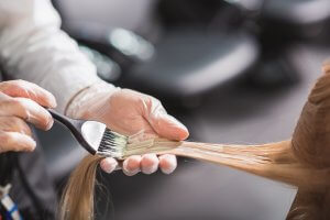 Man dying long brown hair at Perth Hair Salon